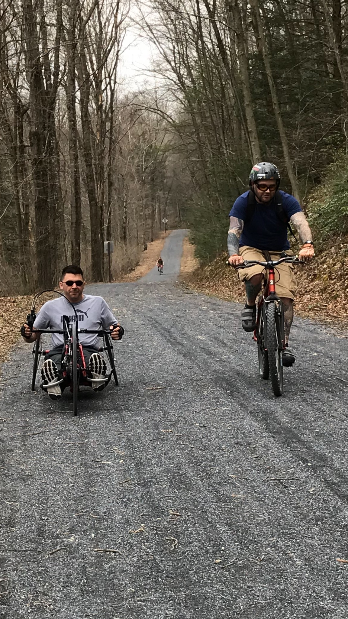 Jeremy Hollinger trail riding with a friend
